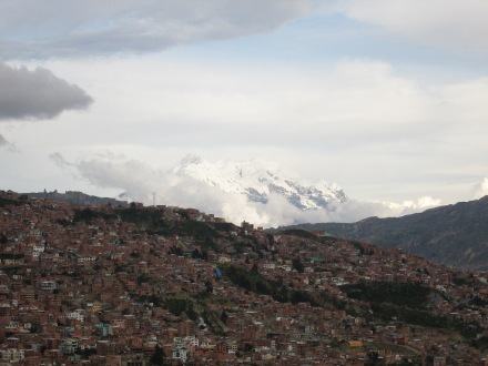 Mountain Illimani towers over La Paz and sits at an elevation of 6438m above sea level